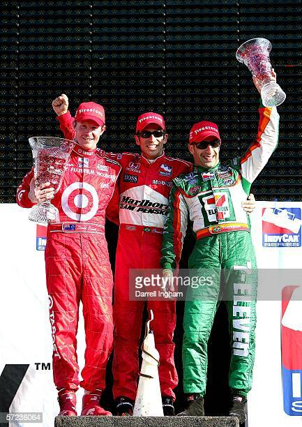 Helio Castroneves celebrates winning with second placed Scott Dixon and third placed Tony Kanaan during the IRL IndyCar Series Honda Grand Prix of...