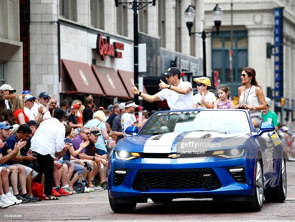 Helio Castroneves driver of the #3 Penske Racing Dallara Chevrolet, waves during a parade ahead of the 100th running of the Indianapolis 500 at on May 28, 2016 in Indianapolis, Indiana.