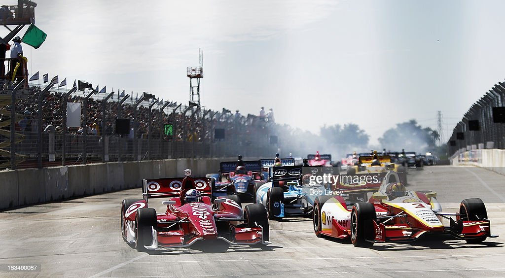 Helio Castroneves, driver of the #3 Team Penske and <a gi-track='captionPersonalityLinkClicked' href=/galleries/search?phrase=Scott+Dixon&family=editorial&specificpeople=183395 ng-click='$event.stopPropagation()'>Scott Dixon</a> of New Zealand, driver of the #9 Target Chip Ganassi Racing Honda Dallara, start the Shell And Pennzoil Grand Prix Of Houston Race #2 at Reliant Park on October 6, 2013 in Houston, Texas.