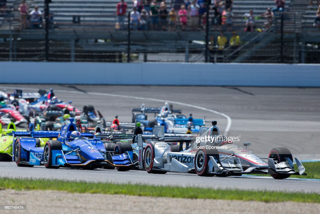 Helio Castroneves, driver of the #3 Team Penske Chevrolet, leads a sea of colors into Turn 2 during the running of the IndyCar Grand Prix on May 13, 2017 at Indianapolis Motor Speedway in Indianapolis, IN.
