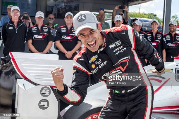 Helio Castroneves of Brazil celebrates after winning the pole position for the Kohler Grand Prix IndyCar race at Road America on June 24 2017 in...