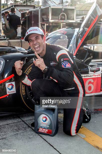 Helio Castroneves of Brazil celebrates after winning the pole position for the Motul Petit Le Mans at Road Atlanta on October 6 2017 in Braselton...