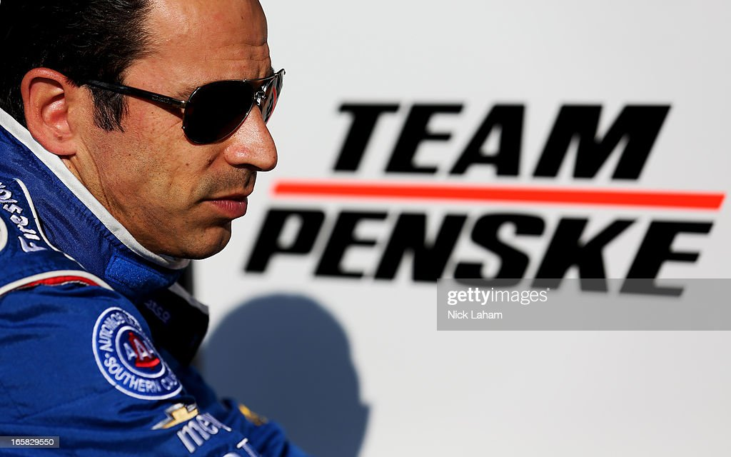 Helio Castroneves of Brazil, driver of the #3 AAA Insurance Team Penske sits on pit wall after practice for the Honda Indy Grand Prix of Alabama at Barber Motorsports Park on April 6, 2013 in Birmingham, Alabama.