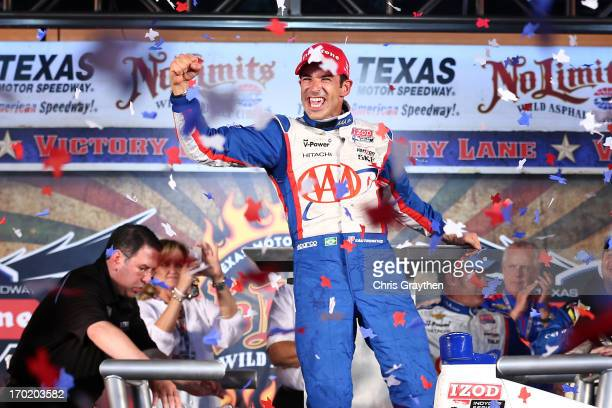 Helio Castroneves of Brazil driver of the AAA Insurance Team Penske Chevrolet celebrates in Victory Lane after winning the IZOD IndyCar Series...
