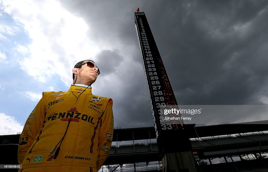 Helio Castroneves of Brazil, driver of the #3 Pennzoil Team Penske Chevrolet Dallara waits to qualify for the 98th Indianapolis 500 Mile Race on May 17, 2014 at the Indianapolis Motor Speedway in Indianapolis, Indiana.