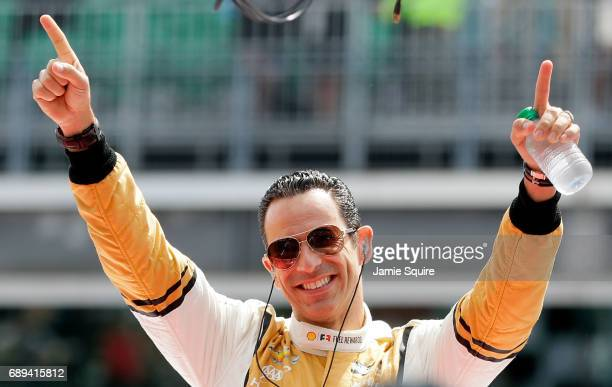 Helio Castroneves of Brazil driver of the Shell Fuel Rewards Team Penske Chevrolet waves to the crowd during driver introductions ahead of the 101st...