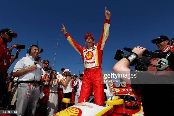 Helio Castroneves of Brazil driver of the Shell VPower/Pennzoil Ultra Team Penske Chevrolet celebrates winning the IZOD IndyCar Series Honda Grand...