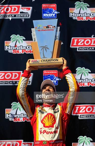Helio Castroneves of Brazil driver of the Shell VPower/Pennzoil Ultra Team Penske celebrates winning the IZOD IndyCar Series Honda Grand Prix of St...