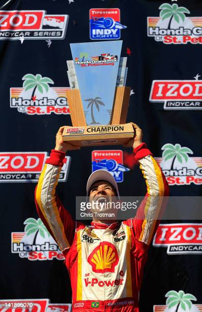 Helio Castroneves of Brazil driver of the Shell VPower/Pennzoil Ultra Team Penske celebrates winning the IZOD IndyCar Series Honda Grand Prix of St...