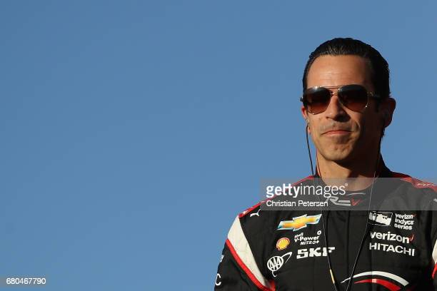 Helio Castroneves of Brazil driver of the Team Penske Chevrolet greets fans as he is introduced to the Desert Diamond West Valley Phoenix Grand Prix...