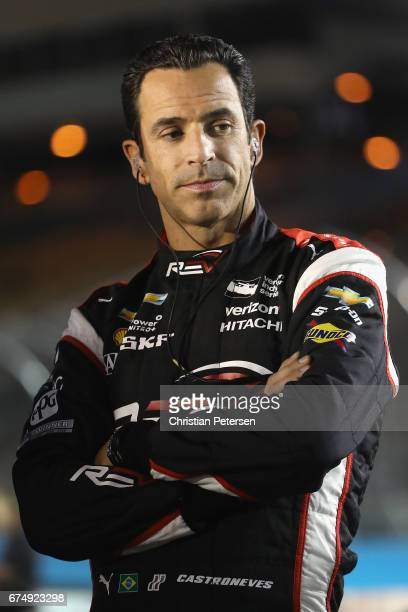 Helio Castroneves of Brazil driver of the Team Penske Chevrolet stands on the grid before qualifying for the Desert Diamond West Valley Phoenix Grand...