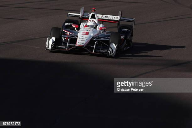 Helio Castroneves of Brazil driver of the Team Penske Chevrolet drives during practice for the Desert Diamond West Valley Phoenix Grand Prix at...