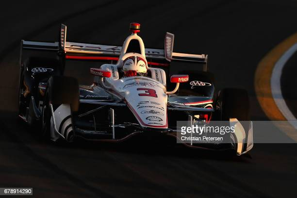 Helio Castroneves of Brazil driver of the Team Penske Chevrolet drives during the Desert Diamond West Valley Phoenix Grand Prix at Phoenix...