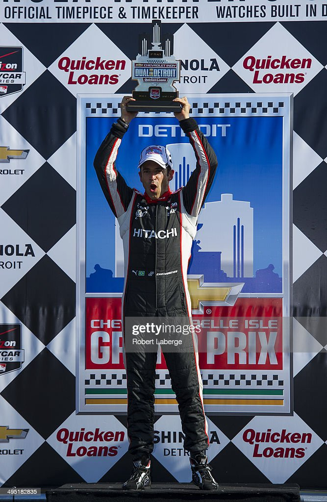 Helio Castroneves of Brazil driver of the #3 Team Penske Dallara Chevrolet celebrates after winning the Verizon IndyCar Series Chevrolet Indy Dual in Detroit Dual II race at Belle Isle Park on June 1, 2014 in Detroit, Michigan.