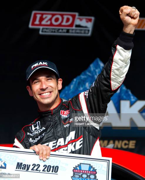 Helio Castroneves of Brazil driver of the Team Penske Dallara Honda celebrates after earning pole position during Pole Day qualifying for the IZOD...