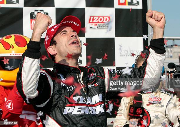 Helio Castroneves of Brazil driver of the Team Penske Dallara Honda celebrates in victory lane after winning the Indy Grand Prix of Alabama at the...