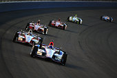 Helio Castroneves of Brazil driver of the Team Penske Dallara Chevrolet leads a group of cars during the Verizon IndyCar Series MAVTV 500 IndyCar...