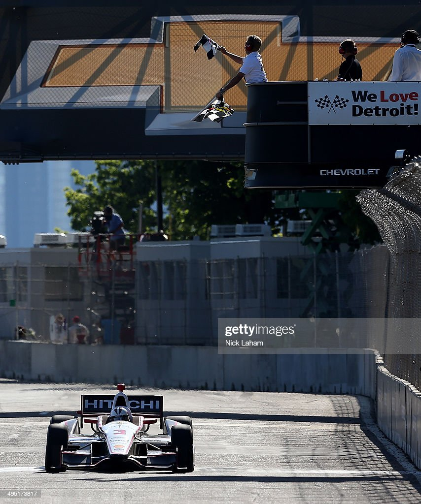 Helio Castroneves of Brazil, driver of the #3 Team Penske Dallara Chevrolet takes the checkered flag to win the Verizon IndyCar Chevrolet Indy Dual II at The Raceway on Belle Isle on June 1, 2014 in Detroit, Michigan.