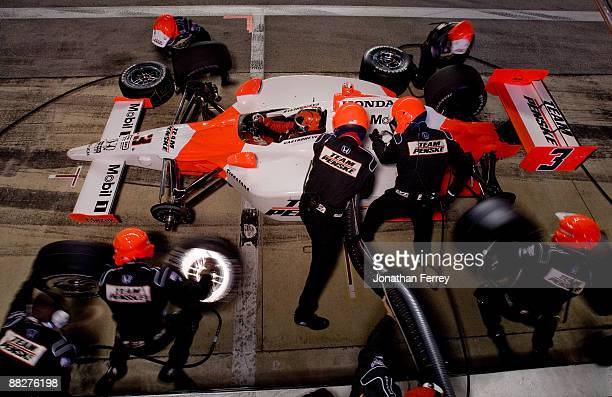 Helio Castroneves pits his Team Penske Dallara Honda during the IRL IndyCar Series Bombardier Learjet 550k on June 6 2009 at Texas Motor Speedway in...
