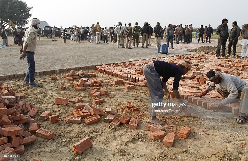 Helipad being prepared on school ground for landing of Chief Minister Akhilesh Yadav's helicopter on January 10, 2013 in Ballia, India. Uttar Pradesh administration is working overtime to prepare for Chief Minister Akhilesh Yadav's expected visit on January 12 to give a cheque to the father of the gangrape victim who died in Singapore after being brutally raped and tortured on a bus.