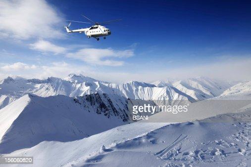 Heliski in snowy mountains : Stock Photo