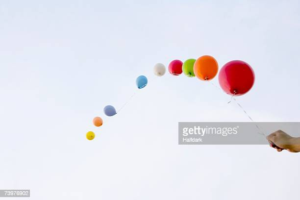 Helium balloons tied to a string