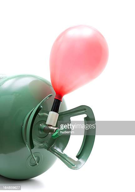 Helium gas cylinder and balloon isolated on white background