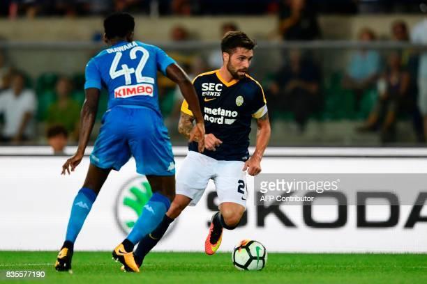 Hellas Verona's Brazilian midfielder Daniel Bessa vies with Napoli's Guinean midfielder Amadou Diawara during the Italian Serie A football match...