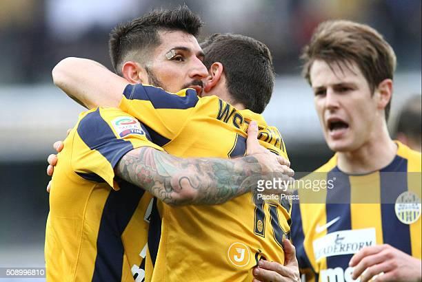 Hellas Verona's defender Eros Pisano celebrates after scoring a goal 21 with Hellas Verona's midfielder Pawel Wszolek during the Italian Serie A...