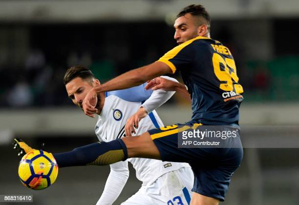 Hellas Verona's French forward Mohamed Fares vies with Inter Milan's Italian defender Danilo D'Ambrosio during the Italian Serie A football match...