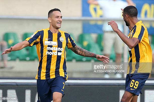 Hellas Verona's midfielder from Serbia Bosko Jankovic celebrates with teammates Hellas Verona's defender from France Samuel Souprayen after scoring...