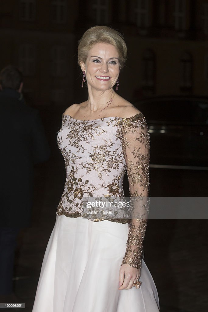 Helle ThorningSchmidt the Danish Prime Minister arrives at the traditional New Year's Banquet hosted by Queen Margrethe of Denmark at Amalienborg...