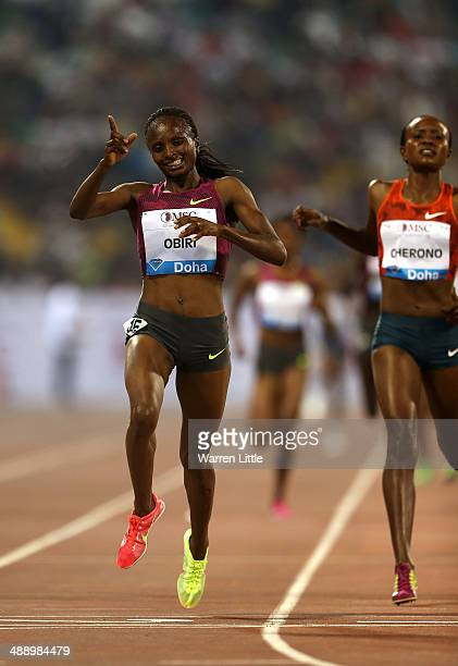 Hellen Obiri of Kenya celebrates winning the women's 3000m at the 2014 Doha IAAF Diamond League at Qatar Sports Club on May 9 2014 in Doha Qatar