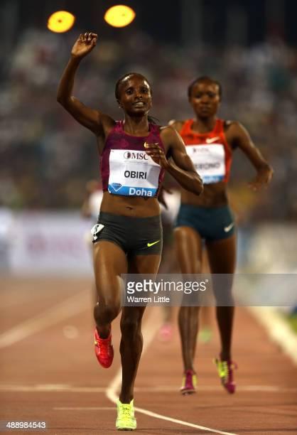 Hellen Obiri of Kenya celebrates winning the women's 3000m at the 2014 Doha IAAF Diamond League at Qatar Sports Club on May 9 2014 in Doha Qatar