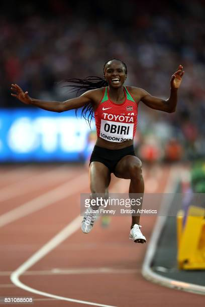 Hellen Onsando Obiri of Kenya celebrates as she crosses the finish line to win gold in the Women's 5000 metres final during day ten of the 16th IAAF...