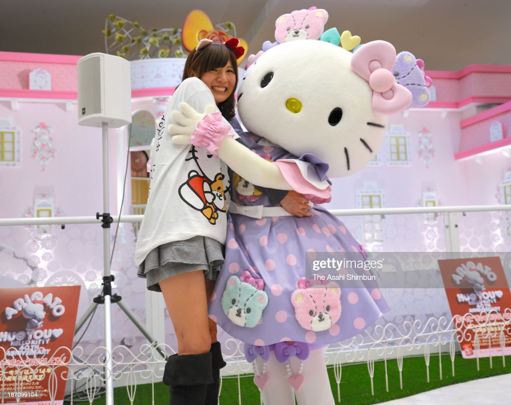 Hello Kitty and a guest hug during the hug with 1,000 guests to celebrate her 39th birthday at Sanrio Puroland on November 1, 2013 in Tama, Tokyo, Japan. The famous character's official birthday is November 1, 1974 and Hello Kitty will attend 40th anniversary celebration events held in Japan and overseas.