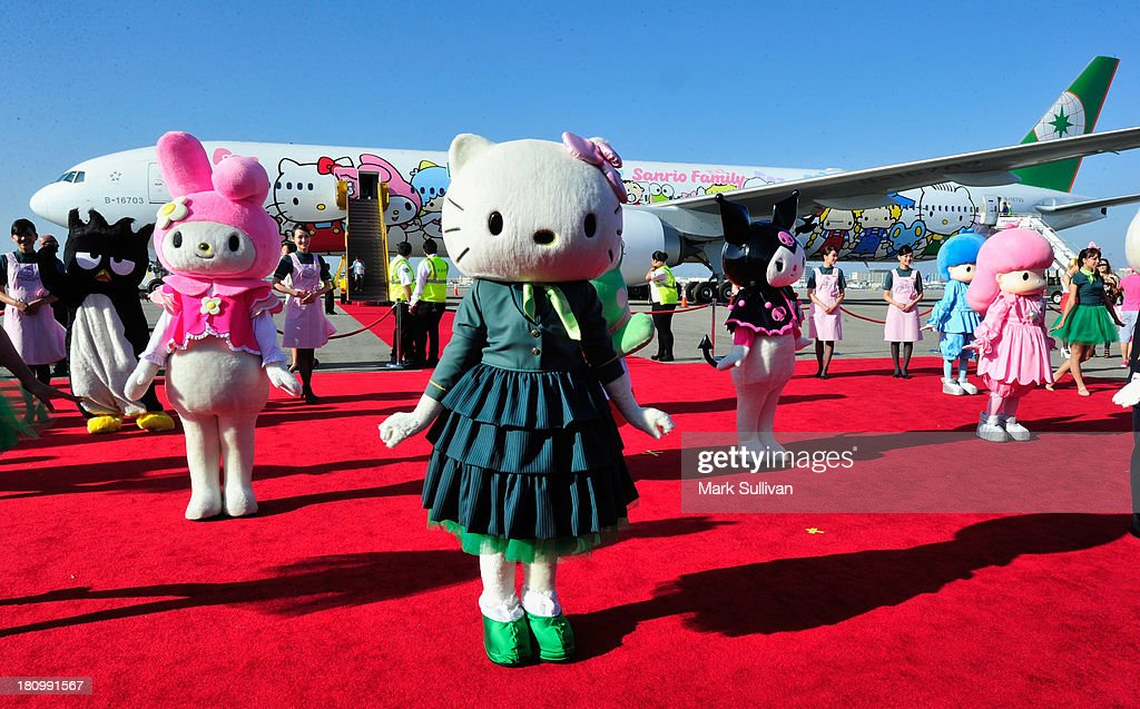 'Hello Kitty' and dancers celebrate the arrival of the EVA Boeing 777-300ER Hello Kitty Jet at LAX Airport on September 18, 2013 in Los Angeles, California.