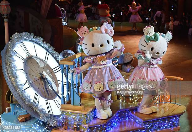 Hello Kitty and her twin sister Mimmy celebrate in the Hello Kitty 40th anniversary parade at Tokyo's Sanrio Puroland on November 1 2014 Hello Kitty...