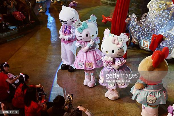 Hello Kitty and her twin sister Mimmy perform with Sanrio characters in the Hello Kitty 40th anniversary parade at Tokyo's Sanrio Puroland on...