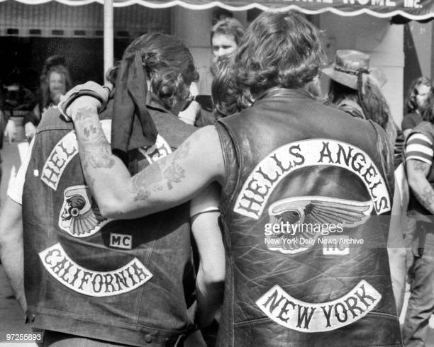 Hells Angels local member from New York consoles mourner from California for Vincent Girolamo outside of Provenzano Funeral Home