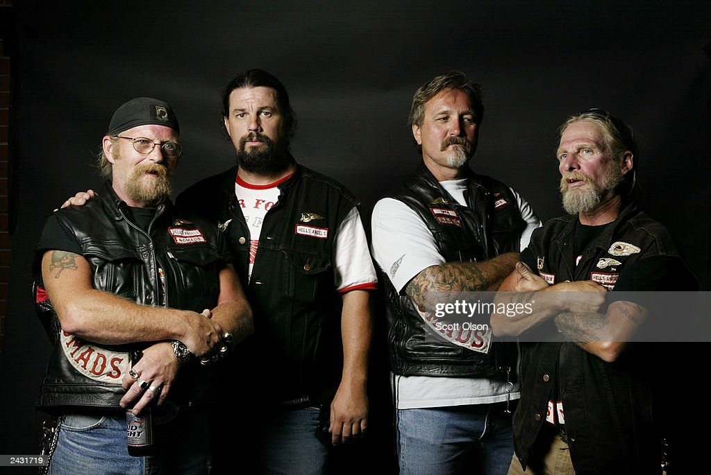 Hells Angels motorcycle club members Mike, Bone, Jammer and Pirate, attend a party August 23, 2003 in Quincy, Illinois. The party was hosted by the Midwest Percenters motorcycle club in Quincy.