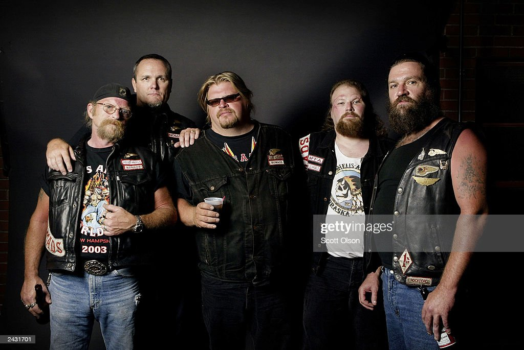 Hells Angels motorcycle club members Mike North, Scott, Ricky, Tim and Donny attend a party August 23, 2003 in Quincy, Illinois. The party was hosted by the Midwest Percenters motorcycle club in Quincy.