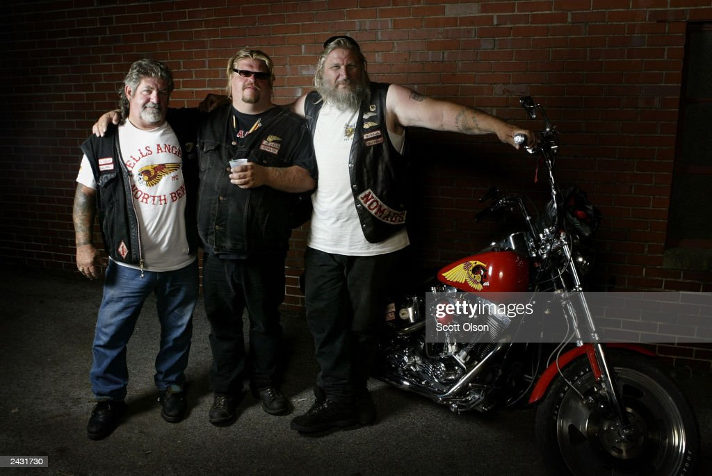 Hells Angels motorcycle club members Moses, Ricky, and Roger stand together as they attend a party August 23, 2003 in Quincy, Illinois. The party was hosted by the Midwest Percenters motorcycle club in Quincy.