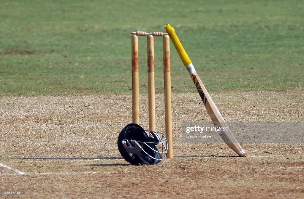A helmet and bat rest against the stumps during Englands game against The Mubai Cricket Association during the first game of the winter Tour of India...