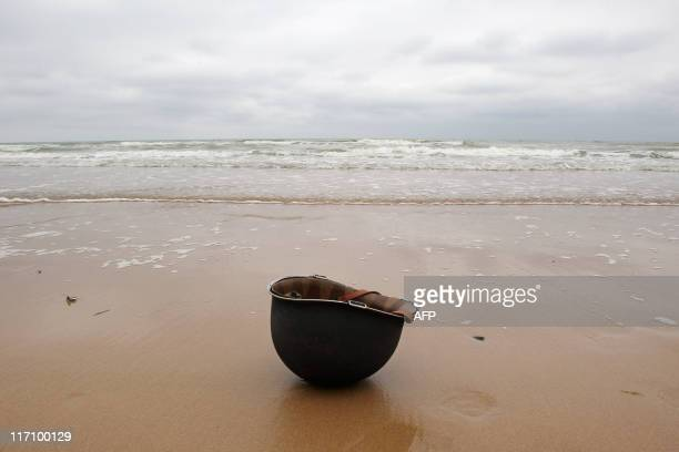 A US helmet is pictured on the beach of SaintLaurent sur Mer western France on June 6 during a ceremony to mark the 67th DDay anniversary on June 6...