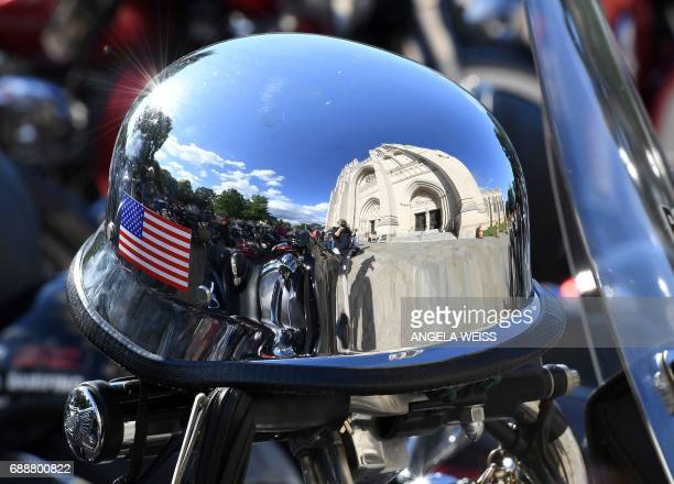 A helmet mirrors the Washington National Cathedral during the 'Blessing of the Bikes' on May 26 2017 in Washington DC / AFP PHOTO / ANGELA WEISS