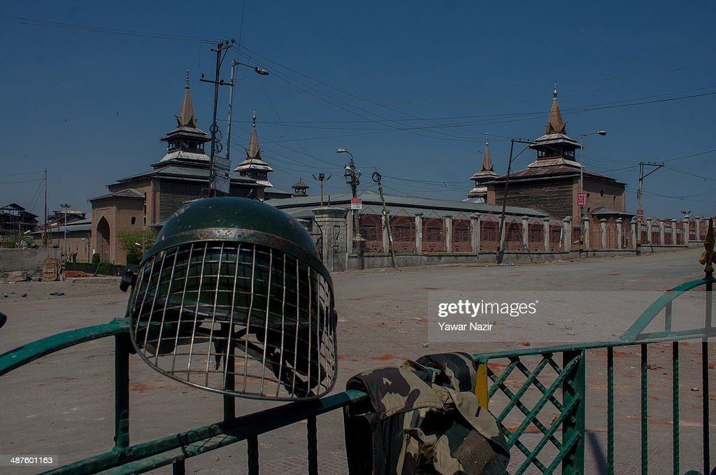 A helmet of an Indian paramilitary soldier lies on a fencing in the old city during a curfew following a killing of a youth on May 01, 2014 in Srinagar, the summer capital of Indian-administered Kashmir, India. Kashmir remained on boil a day after a youth was shot dead by Indian armed government forces in the Old City of Srinagar. Two persons including a woman were also wounded when Indian forces fired at Kashmiri stone hurling protesters who were shouting 'down with India' slogans. The Indian forces in Kashmir clamped a stringent curfew in the region to stop anti-India protests from escalating while as a shutdown was observed to protest the killing of the youth.