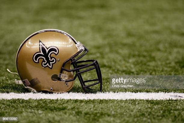 A helmet of the New Orleans Saints sits on the ground before the game against the Dallas Cowboys at the Louisiana Superdome on December 19 2009 in...