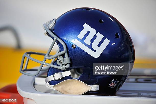 A helmet of the New York Giants rests on the sideline during a game against the Tennessee Titans at LP Field on December 7 2014 in Nashville Tennessee