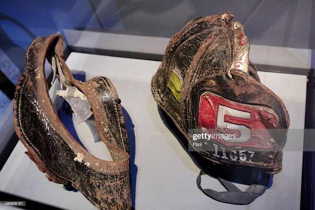 A helmet worn by New York City Fire Department Firefighter Christian Waugh on September 11, 2001 is displayed during a press preview of the National September 11 Memorial Museum at ground zero May 15, 2014 in New York City. The museum spans seven stories, mostly underground, and contains artifacts from the attack on the World Trade Center Towers on September 11, 2001 that include the 80-foot high tridents, the so-called 'Ground Zero Cross,' the destroyed remains of Company 21's New York Fire Department Engine as well as smaller items such as letter that fell from a hijacked plane and posters of missing loved ones projected onto the wall of the museum. The museum will open to the public on May 21.